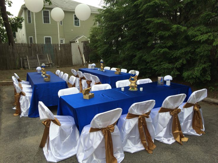 Simple table decor royal blue , gold and white