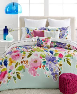 For cool, contemporary style and a burst of color that will brighten your bedroom, this Wisteria full/queen duvet set from bluebellgray features ultra-soft fabric finished with a refreshing mint groun