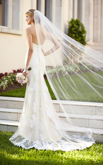 Fabulous This lace over matte side Lavish satin wedding gown from Stella York features hand sewn embellishments on lace appliques The strapless sweetheart neckline