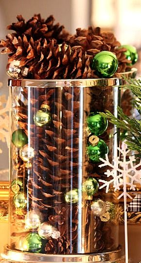 glass hurricane with pine cones....