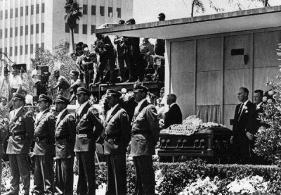 """Marilyn Monroe's funeral was arranged by her second husband, Joe DiMaggio. It was a small service, with only close family and friends attending. She was buried in what was known as """"the Cadillac of caskets"""", made of solid bronze and lined with champagne colored silk. Police were present to keep the press and public away from the funeral. They are seen guarding her casket in this print. Find it at http://www.photosalon.com/store/people/marilyn-monroe/2638970.html"""