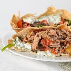 A slow cooker Greek lamb recipe perfect to stuff into pitas with tzatziki for an easy meal of gyros.