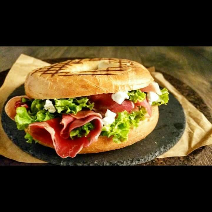 Bagel with feta cheese and prosciutto foodstyling