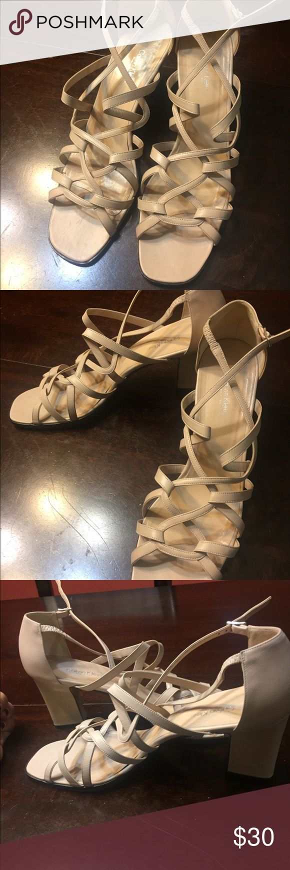 Calvin Klein nude strappy chunky  3 inch heels 👠 Up for sale are a pair of Nude Calvin Klein strappy open toed heels. Heel height is 3 inches. This is in great condition. Perfect for your spring wardrobe! Calvin Klein Shoes Heels