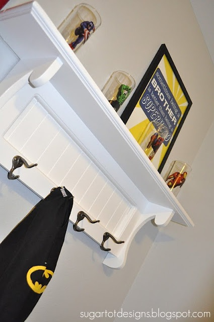 """superhero bedroom - superheros need a place to hang their capes - note the framed quote art """"sometimes being a brother is better than being a superhero"""""""