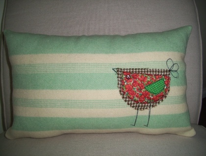 Wool blanket cushion cover with appliqued bird