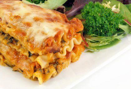 This Vegetarian Lasagna is made with layers of diced tomatoes, noodles, fresh spinach, carrots, zucchini, summer squash, oregano, mozzarella and ricotta cheese.