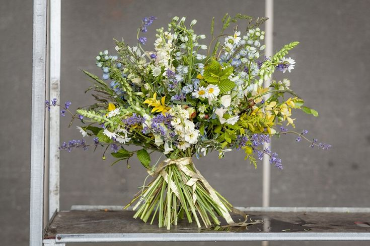 #britishflowersweek #2015 New Covent Garden Flower Market | Wild and loose and overflowing with locally-grown nepeta, delphinium, astrantia, ox-eye daisies, foxgloves, stocks and peonies, offset by the green tones of hornbeam, cotoneaster, a hint of silver eucalyptus, and the yellow pop of euonymous and golden privet.