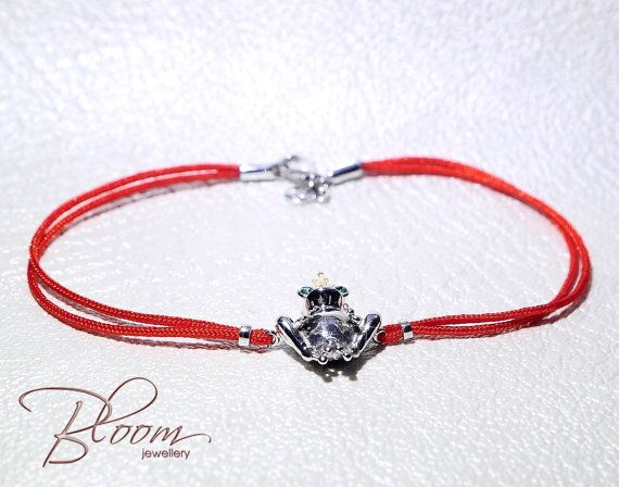 White Gold Frog Bracelet 14K Solid Gold Red String of Fate Gold Kabbalah Bracelet Prince Frog Kabbalah Bracelet Gold Red String Bracelet Protection against evil or fashion accessory?... Red string bracelets are very popular these days. Original gift, marriage proposal or it is so cute. You cant miss The Frog King. Description: 14kt white gold frog, yellow gold crown, white gold clasps - 2.60 gr. Green colour cubic zirconia stones - high grade Length - fixed 16 cm. Package - burgundy red...