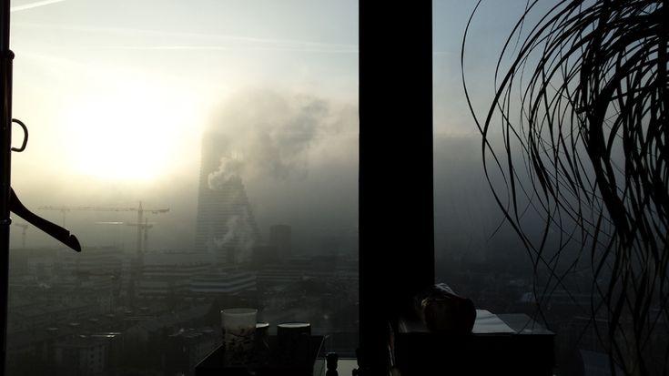 basel city skyscraper messeturm modern view roche tower heavy mist moody creepy