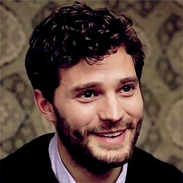We should all spend our days on our hands and knees worshiping the sight of Jamie Dornan's beautiful smile.