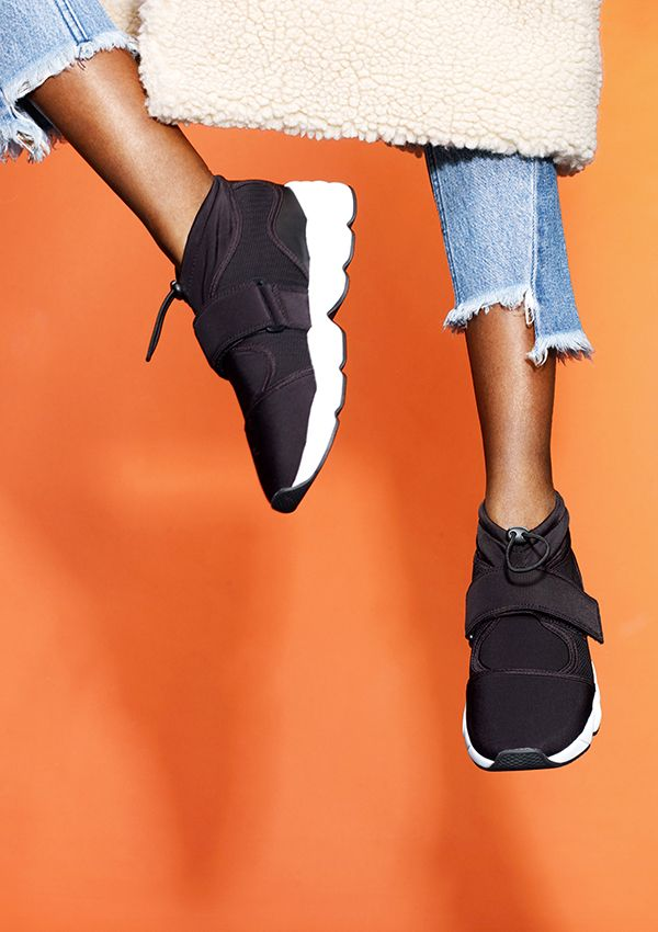 Scuba panelled sneakers with velcros straps, drawstring tie and contrast white rubber soles are where this season's musthave shoes are at.