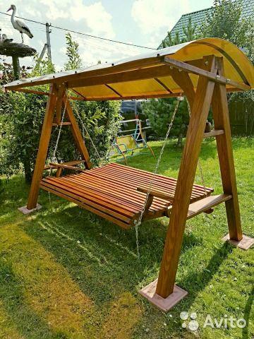 Шикарные деревянные садовые качели— фотография №7