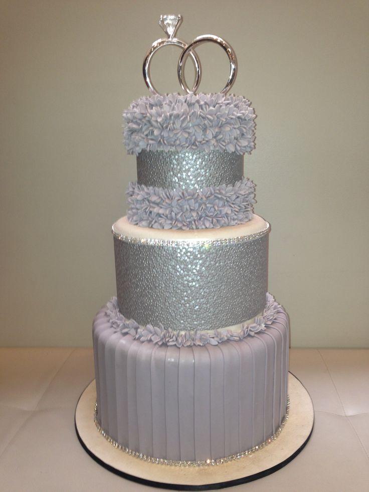 Amazing Silver Wedding Cake #frills #style #bride #groom #rings