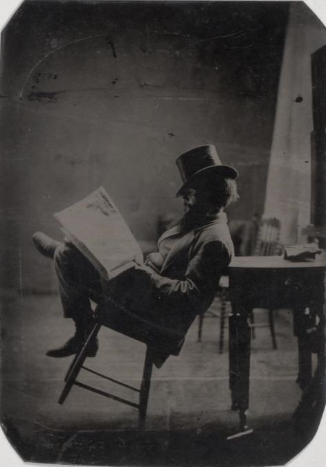 ca. 1880, portrait of a gentleman reading the newspaper