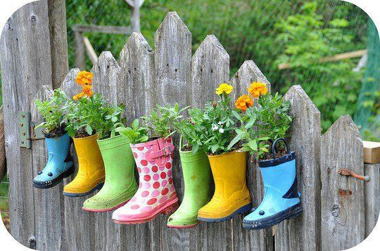 """Great way to add color and use """"lost"""" items.Rainboots Planters"""