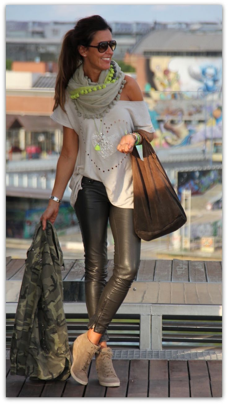 leather pants, loose shirt, and scarf. love!