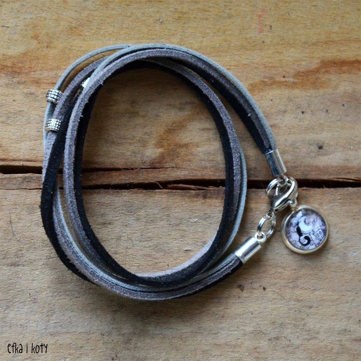 grey bracelet with cat