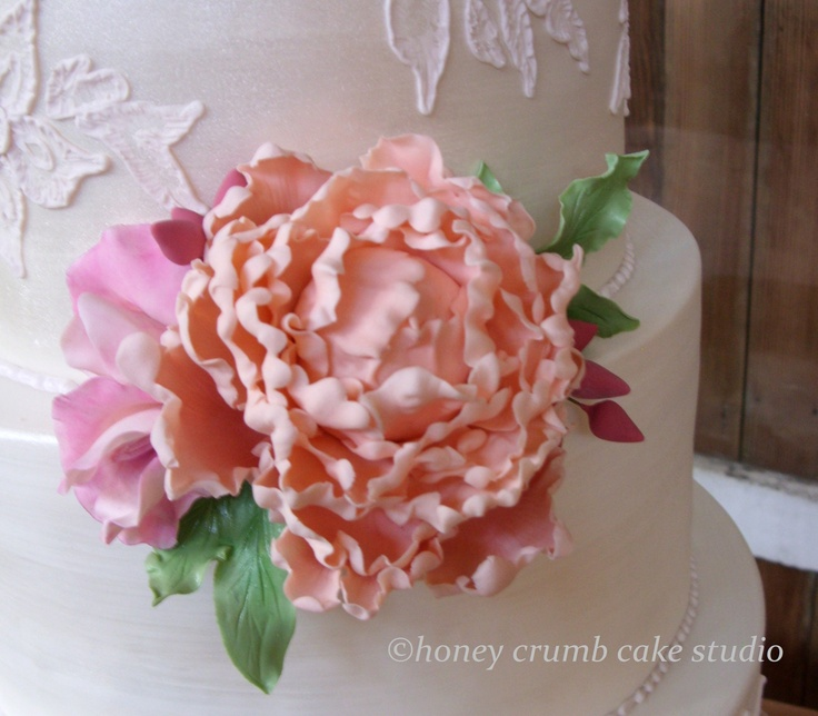 sugar peony in blush pink accompanied by sugar sweet peas and peony