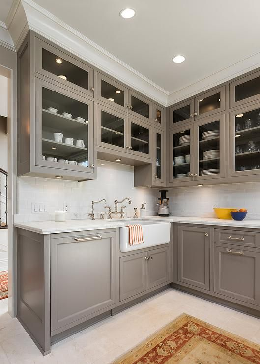 superb I Want To Paint My Kitchen Cabinets #6: Beautiful kitchen features gray cabinets painted Benjamin Moore River Reflections paired with honed carrera marble countertops and white subway tiled ...