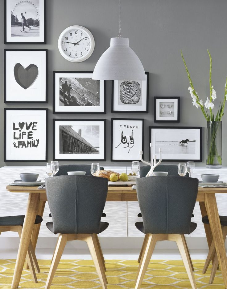 Grey modern dining room with black and white pictures
