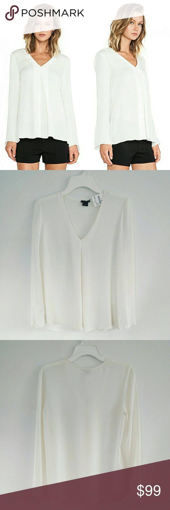 """Theory Trent Long Sleeves Silk Blouse Top Ivory S Classic flowy blouse top crafted with 100% silk, features modern V-neckline and inverted front pleat. Model is 5'11"""" wearing size S. Measures at about 36"""" at chest, 22.5"""" sleeves length, 26"""" length from shoulder to hem. Brand new with tags except few minor pulls and snags around shoulder area, pls see pic#4.  Caring tips: I'm a fan for silk fabric and most of the them required dry clean. I usually hand wash them at home with regular shampoos…"""