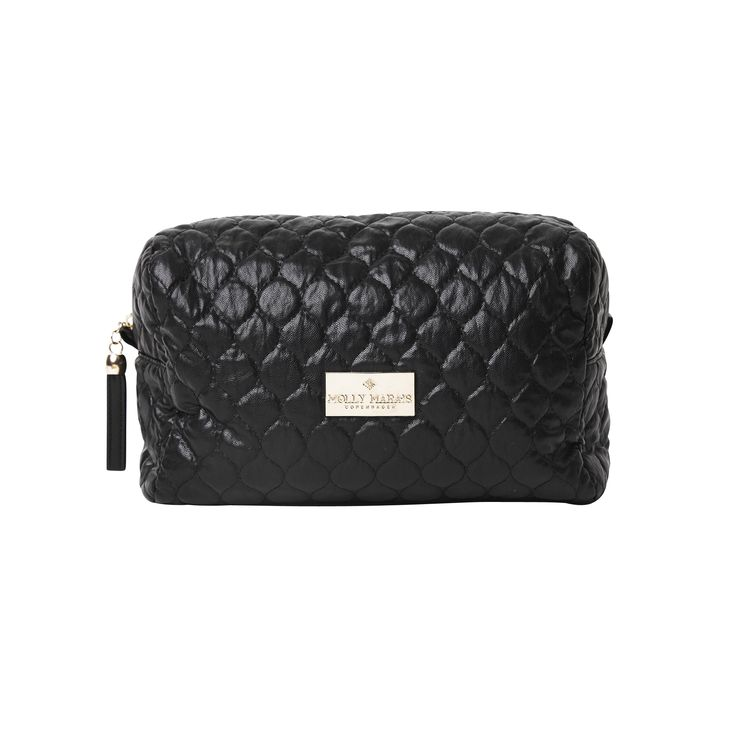 Black cosmetic pouch, faux leather. Molly Marais.