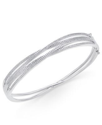"""Understated sparkle adds shimmer and depth to this high-style orbital twist bangle bracelet featuring single-cut diamonds (1/3 ct. t.w.). Set in sterling silver. Approximate diameter: 2-1/3"""".   1/3 Ca"""
