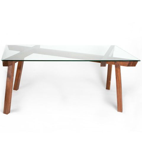 ZAN Dining Table by Seiji Kuwabara.  Glass topped table with a base of walnut beams placed at unexpected angles.  Available at Kozai Modern  $4,700