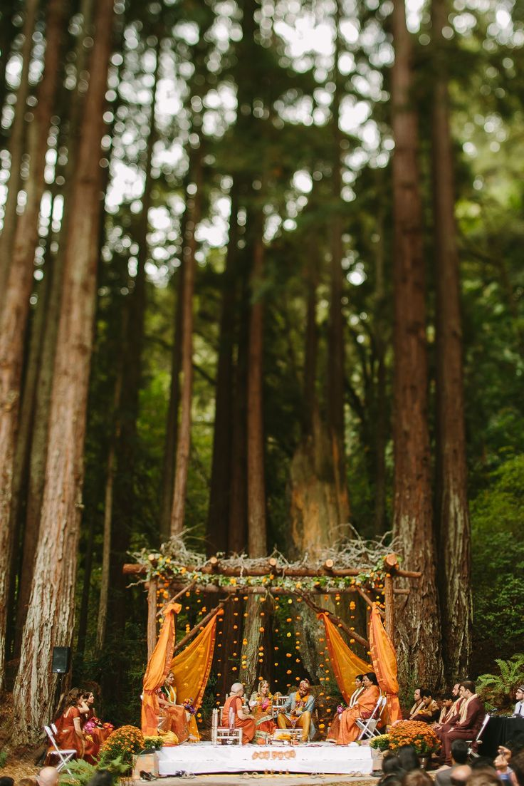"Okay all you Rustic Wedding Chic readers hold on tight because this wedding is about blow you away. This amazing wedding was able to blend together a rustic style with a traditional Indian wedding and ceremony and it is nothing short of breathtaking. The event planner calls it a ""Boho-Chic Indian Fusion wedding"" and we think that is a pretty good way to sum up all the beauty packed into this one wedding. This wedding took place in Aptos, CA with tons of DIY elements to it and was held at the…"