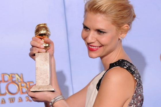 The winner for Best Performance by and Actress In a Television Series Drama Claire Danes poses with the trophy at the 69th annual Golden Globe Awards at the Beverly Hilton Hotel in Beverly Hills, California, January 15, 2012. AFP PHOTO / Robyn BECK (Photo credit should read ROBYN BECK/AFP/Getty Images)