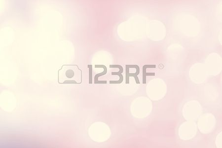 Elegant Abstract Defocused background with natural bokeh.  Blurred bright pink and white background with soft lights.
