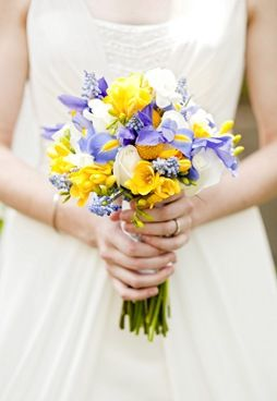 purple and yellow wedding bouquet. These are the colors I used for my wedding. I wanted purple iris with yellow daffodils, but they were just out of season. :(