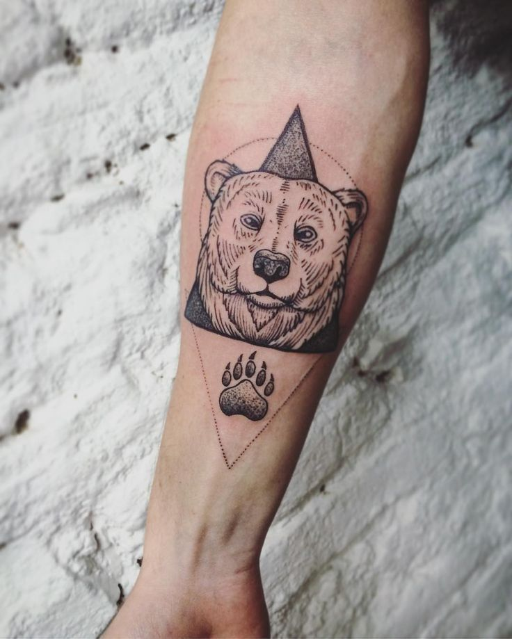 Amazing lined and geometric bear tattoo on the forearm