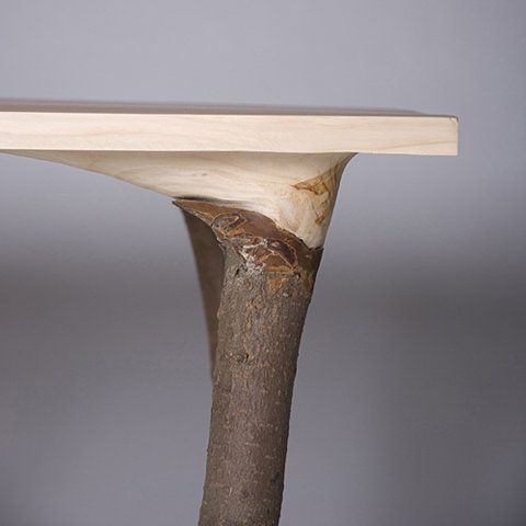 Beautiful idea to take a tree and plank it in a way that the branches form the legs of the table. Beautiful imagination....