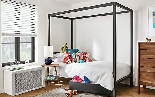 Our Architecture steel kids' bed adds industrial style with strong lines and impressive scale. Handcrafted in Minnesota from natural steel, each frame bears subtle weld marks and slight color variations that make it unique. Choose the Tall profile for greater clearance between the side rails and the floor. Twin sizes available in standard profile only.