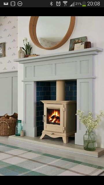 Love the tiles behind the cream log burner