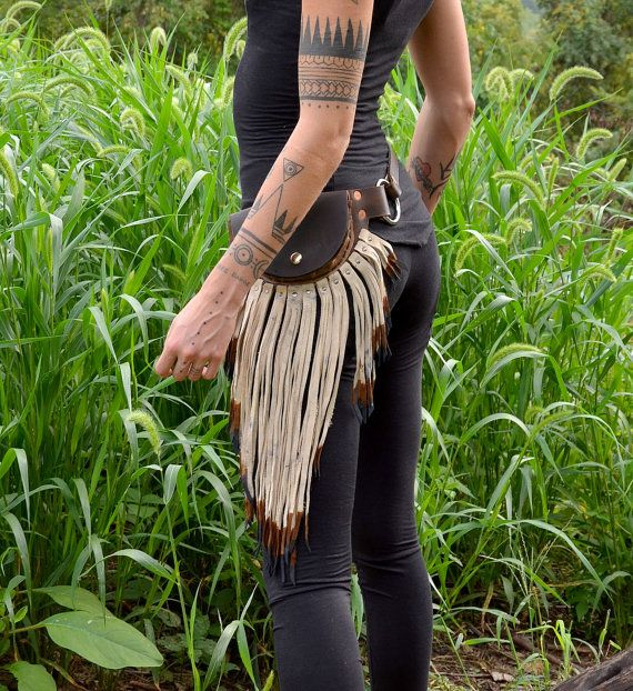 arm tattoos and leather pouch belt
