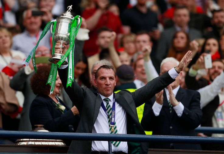 Celtic manager Brendan Rodgers lifts the trophy as he celebrates winning the Scottish Cup