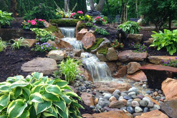 23 Absolutely Gorgeous Pondless Disappearing Waterfall Designs For