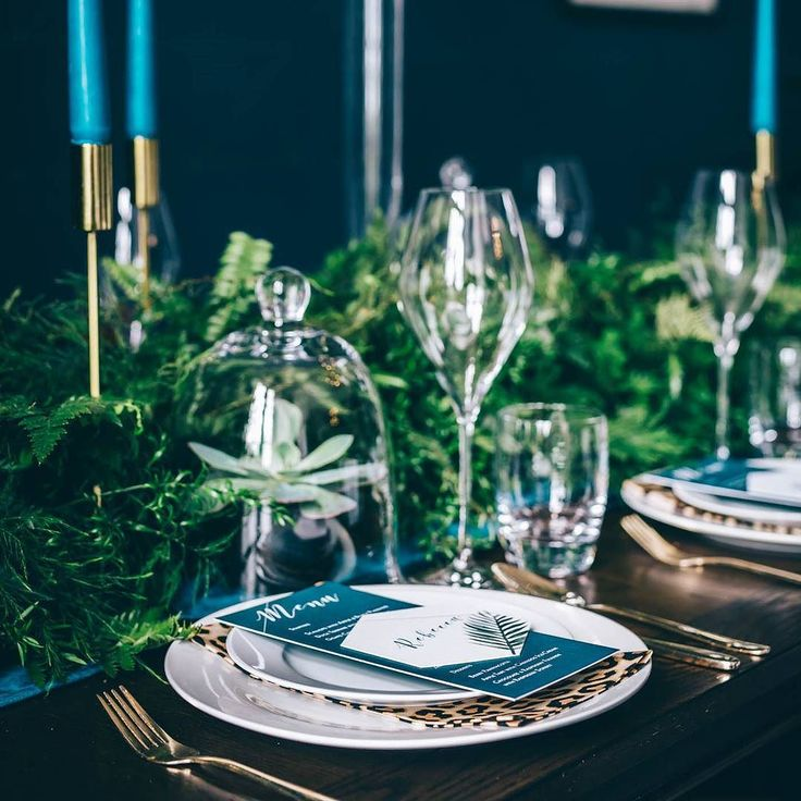 If you are struggling to figure out how to decorate your tables at your wedding then get in touch as I'd love to work with you on a design! This was my design for our Jungle Luxe shoot and I layered modern white crockery with gold cutlery and leopard print napkins with succulents in bell jars and modern teal tapered candles and gold candlesticks. The lovely @amanda.winsor made a beautiful foliage runner to complete the look. ///// Photography @maxiphotographydevon