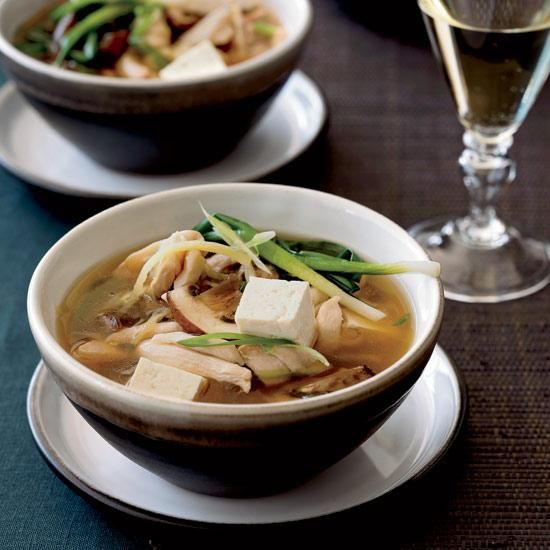 Chicken Hot Pot with Mushrooms and Tofu | Cooks in Asia serve hot pots communally, setting a big pot of bubbling broth on the table alongside a platter of raw ingredients (like vegetables and thinly sliced chicken) for dipping. It's a fun way for guests to feel like they have a hand in making their own meal, and it's inexpensive, too. In this version, each person at the table can have an individual bowl of sliced mushrooms, tofu and scallions, then adds piping hot chicken broth loaded with…