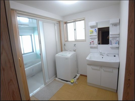 The washing machine hook-up is sometimes located near the bathroom sink. looks like an x on floorplans. unusual japanese appliances in apartments