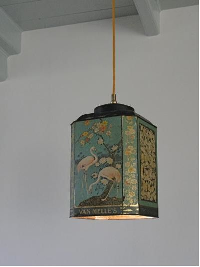 This great idea comes from Hans Groenwold.   Look up his work!  The lights are made from vintage tins.  Maybe it would just be easier to buy one of his impeccable made lights!
