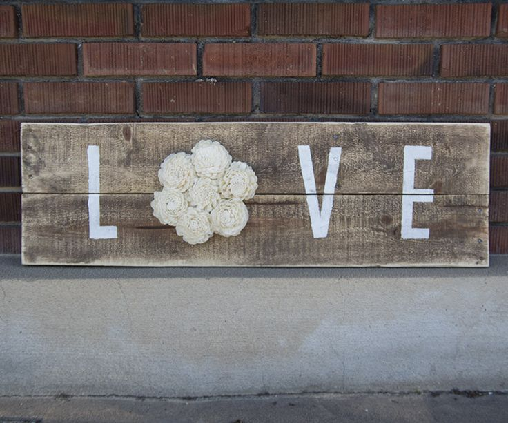 "Reclaimed Pallet Wood Sign - LOVE 38""X11"" Choose your own color!  Rustic pallet wood with the word ""Love"" is completed by adding our beautiful sola wood flowers.    38 inches X 11 inches.  Includes mounting bracket on the back for easy hanging.  Color shown is natural white."