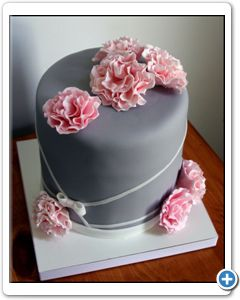 A Few Flowers On Top Of The Wedding Cake.