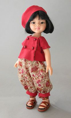 Perky in red,  After dedicating her Kuschelchen dolls to her granddaughters, Viola and Camilla, bear and dollmaker Ruth Treffeisen of Germany, thought it only fair to dedicate her Little Stars in the Doll Sky line to her youngest granddaughter, Alina.
