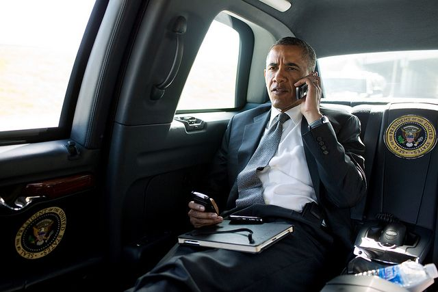 President Barack Obama talks on the phone with Aurora Mayor Steve Hogan during the motorcade ride to Palm Beach International Airport in Palm Beach, Fla., July 20, 2012. The President called Mayor Hogan to offer his condolences and support to the Aurora community.
