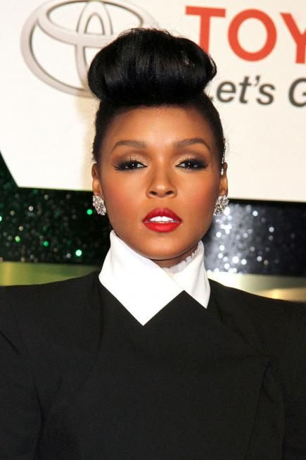 Janelle Monae's iconic coif is easier to get than you think. With a curling iron and come clips, you can rock this look too! #shorthair #updos
