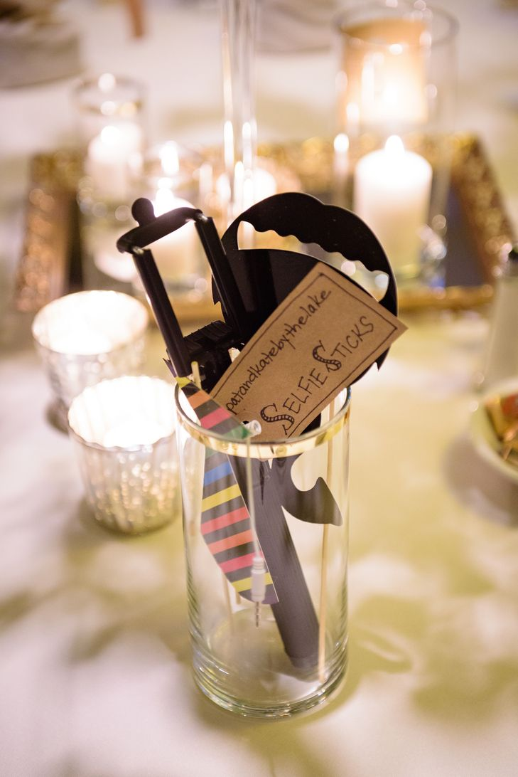 Selfie Sticks at wedding reception © Purrington Photography